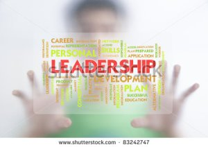 stock-photo-man-pushing-the-business-word-cloud-on-transparent-screen-leadership-83242747
